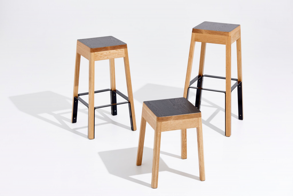The solid timber and steel stool is practical in its design form and robust in strength