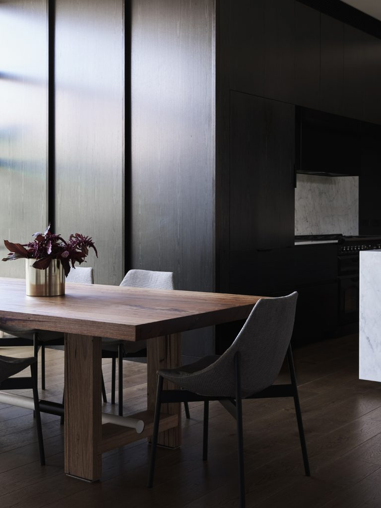 The New Dining And Living Areas Have Been Subtly Separated By A Dark Stained Kitchen 'pod'.
