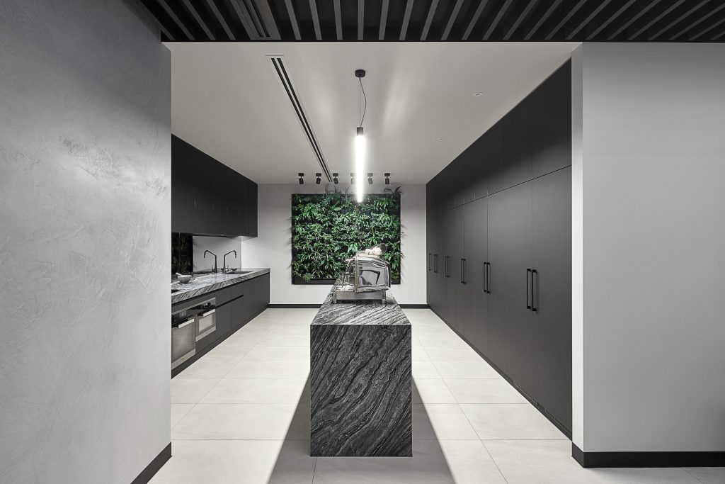 The Office Conveys A 'new York Loft' Feel By Utilizing Full Height Steel Framed Doors And Dark Timber Panelled Ceiling.