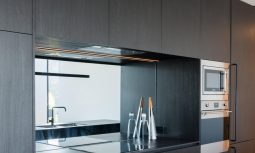 Dark Stained Timber Kitchen Joinery Creates Continuity With The Exterior Cladding, And Contrast With The Predominant