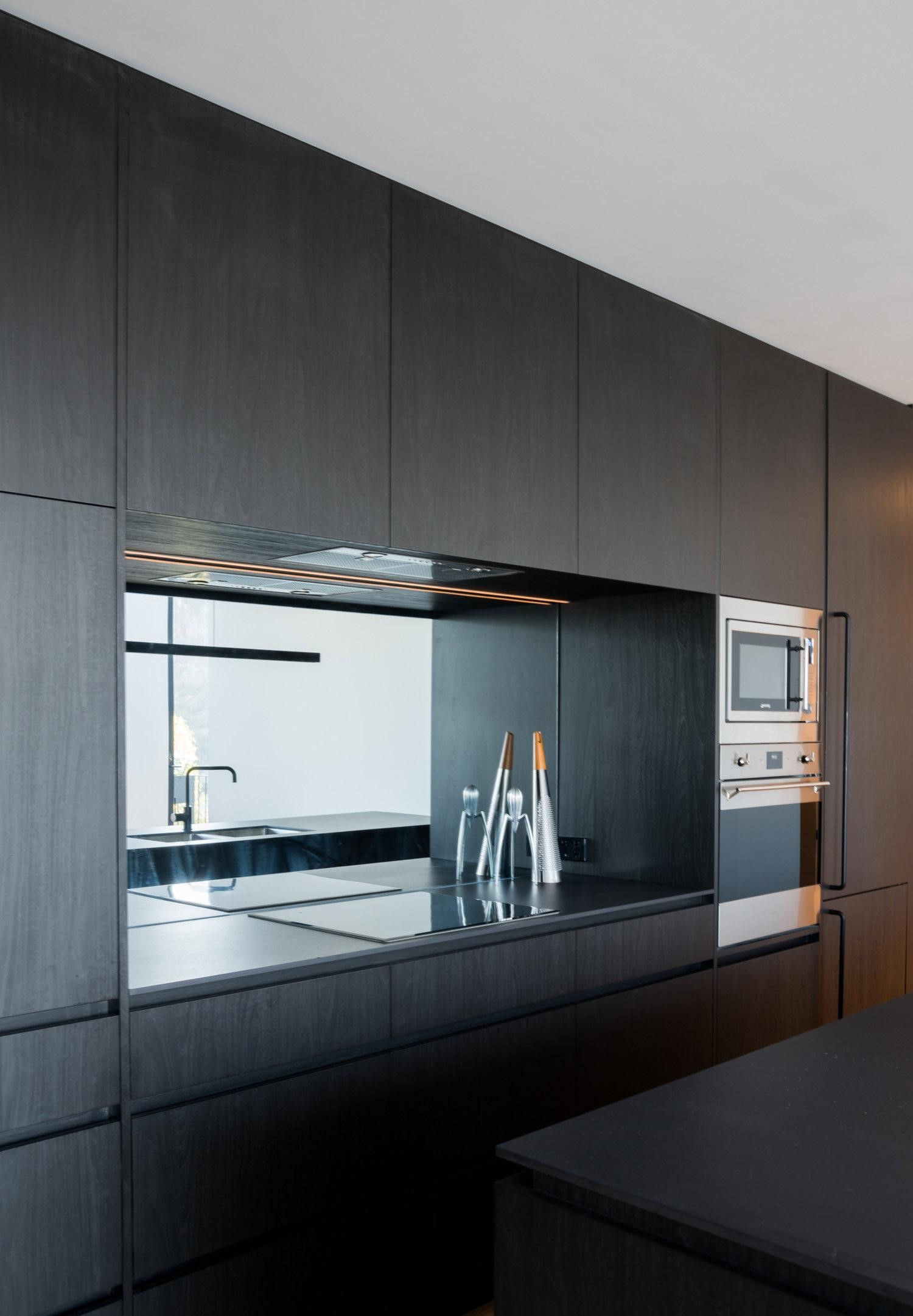 Dark Stained Timber Kitchen Joinery Creates Continuity With The