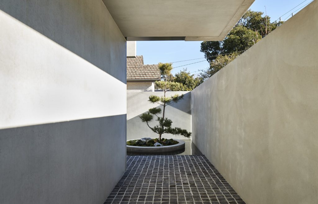 A Strong Design Language Is Expressed Via The Unique Elevation Of The Land Paired With Solid Sheets Of Concrete