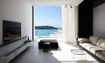 At Each End Three Massive Glass Panels Slide Up And Down To Access Light, Ventilation And Views