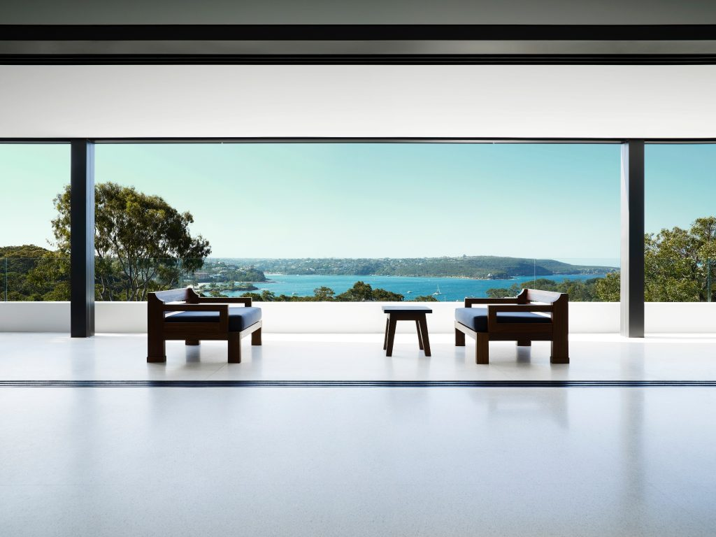 Which Opens Onto A Covered Terrace With Views To The Water And Bushland Beyond.
