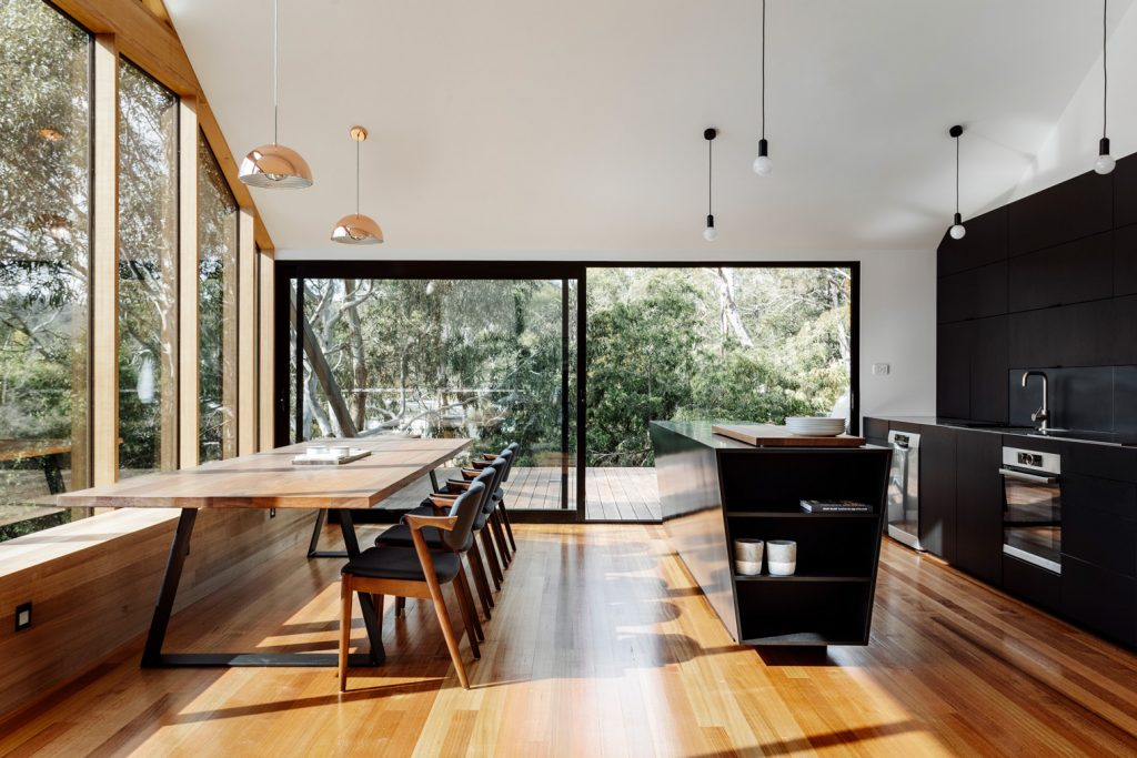 The Dark Exterior, That Recedes Amongst The Trees As Shadowy Form, Is Carried Through Internally To The Blackened Timber Kitche