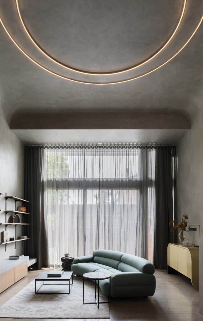 Brass Accents And Statement Lighting. The Furniture Selection Features Geometric Forms And A Muted Palette, Underscoring The Overall Conce