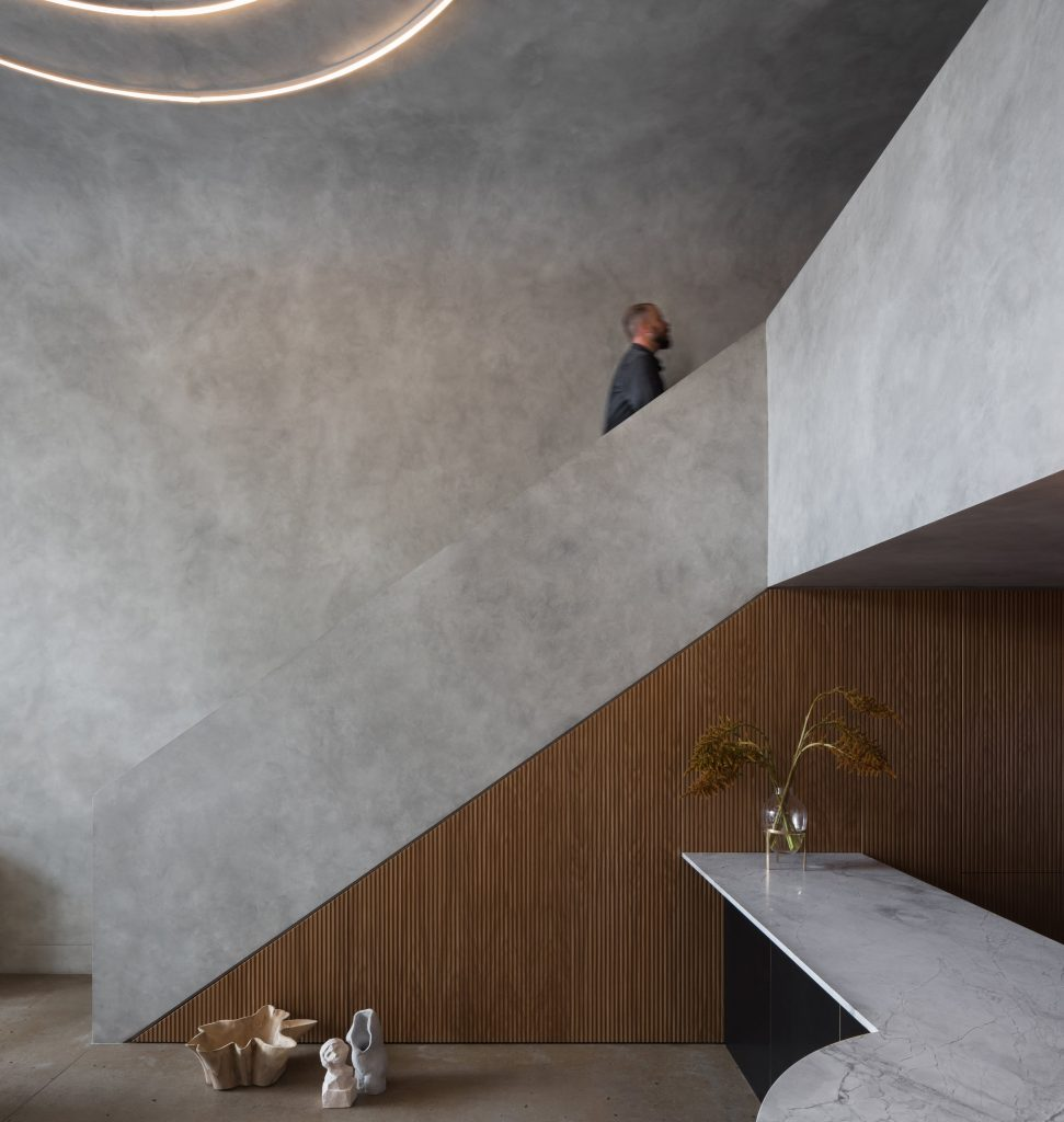 As Seen In The Fluted Kitchen Joinery, Curved Ceiling Forms An D The Cement Rendered Bathroom