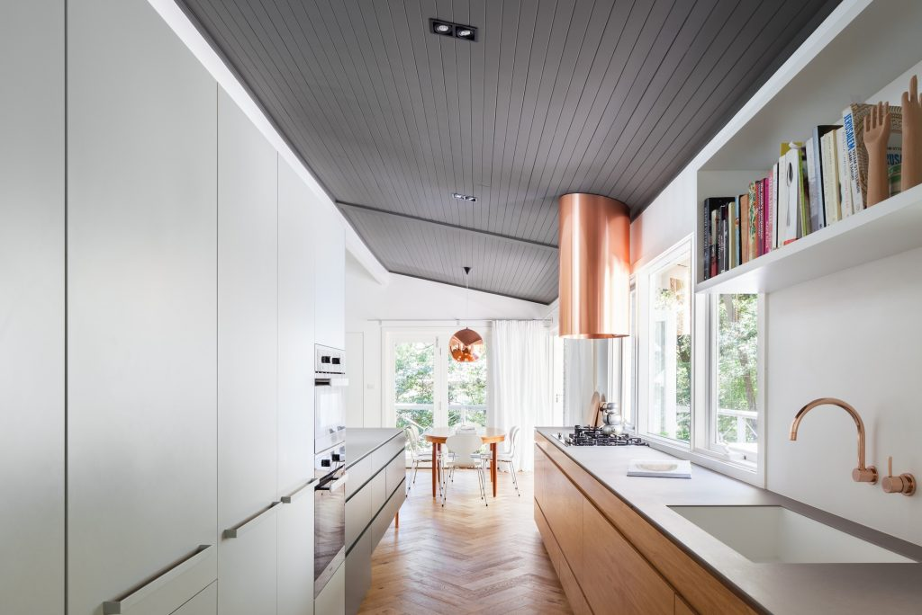 Nestled Into Its Own Treetop Setting, Riverview House Sees The Architects Opening The Original Home's Bones To Engrain A Sense Of Connection A