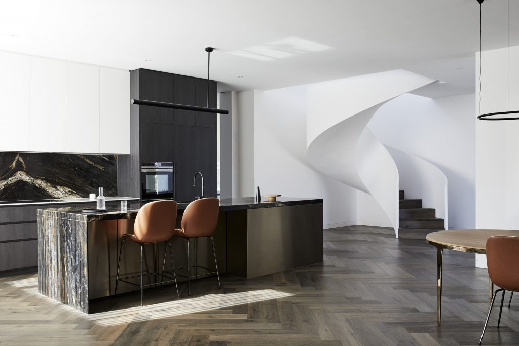 Where A Large Herringbone Pivot Door And The Sculptural Spiral Staircase Instantly Catch The Eye