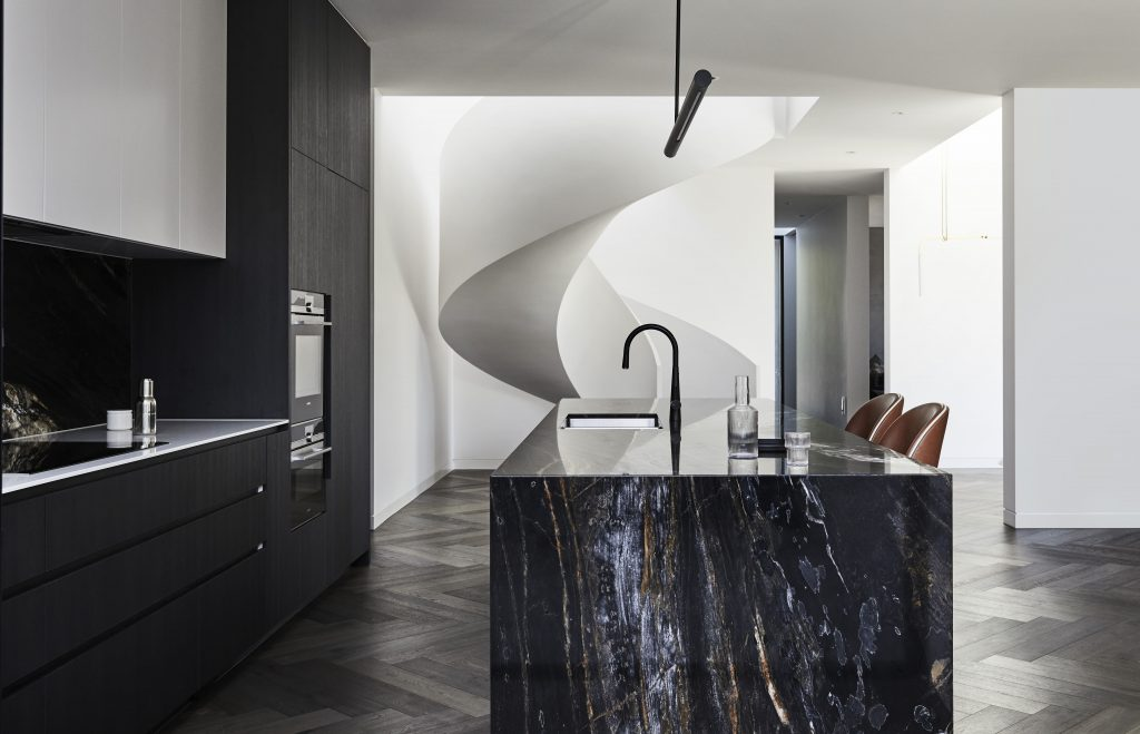 Creating A Balance Of Warmth And Drama That Is Juxtaposed By Subtle Injections Of Light Marble