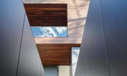 The Rich Spotted Gum Exterior Cascades To Street Level From Its Slanted Site And Is Generously Layered With Lush Tropical Plant