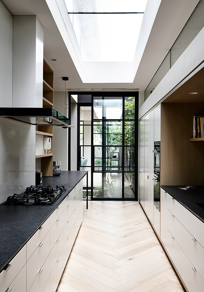 Tasked With Admitting As Much Sun And Warmth Into The Existing Three Level Townhouse As Possible, The Integration Of New Openings Had