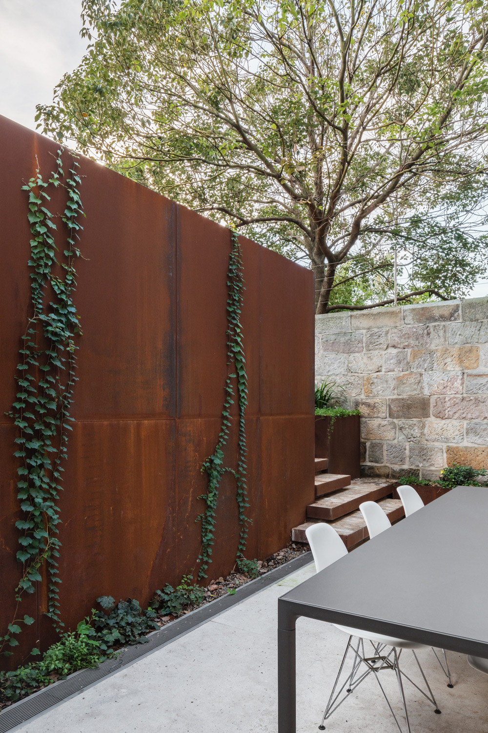 Glazed Tiles Cladding The Length Of The Wall Behind The Back Bench Subtly Echoes The Texture Of The Rough Hewn Limestone, While