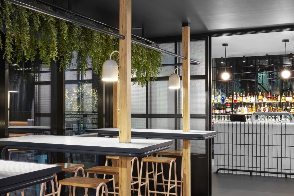 The Space Was Broken Into Separate Zoned Areas, With A Central Bar Facing Towards The Entry Area