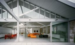 The Original Brick Walls Have Been Purposely Exposed And The Large Timber Trusses Are Celebrated