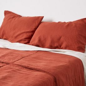 100% Linen Quilted Bed Cover In Brick By In Bed Image 01
